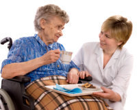 Serving coffe to elder woman