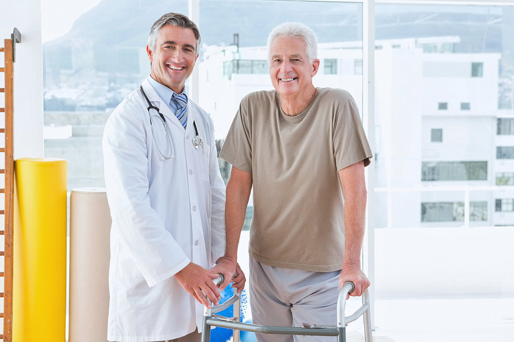 a doctor and a elder man smiling
